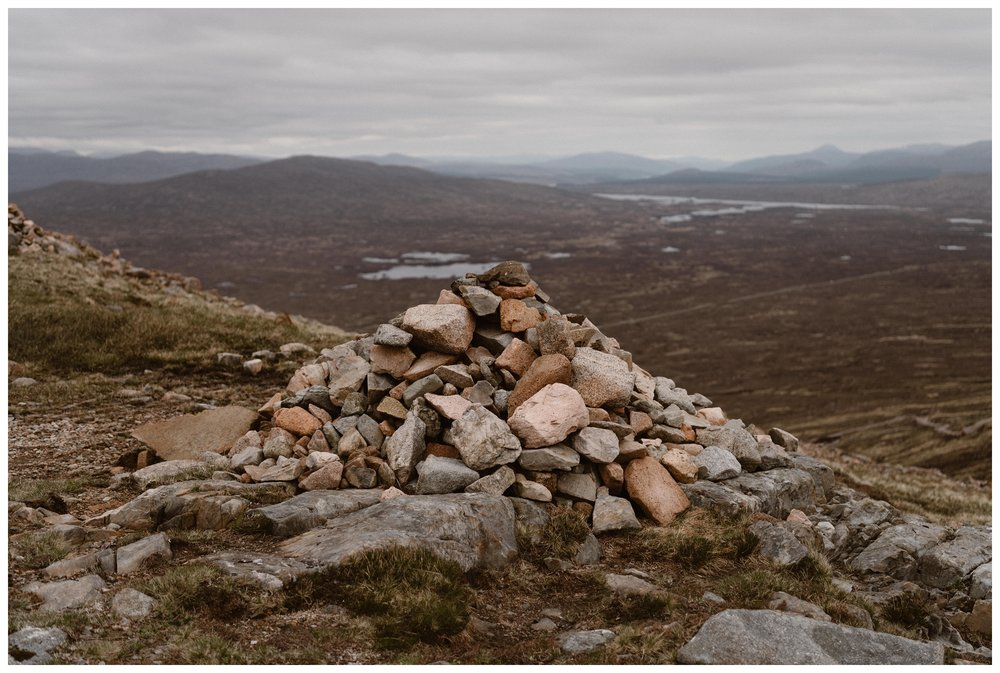 A cairn is a stack of stones that marks a trail. Elissa and Daniel added their own stones to a cairn near their elopement ceremony site in the Scottish Highlands. Photo by Maddie Mae, Adventure Instead.