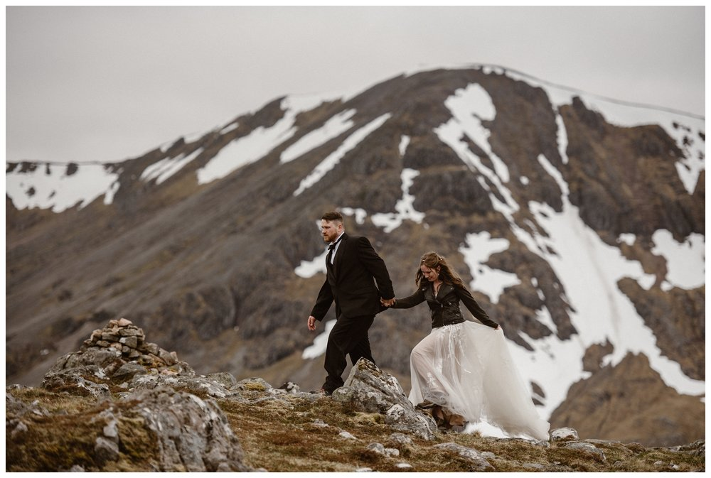 Elissa and Daniel hiked to the top of a mountain in the Scottish Highlands to privately say their vows in a self solemnizing elopement ceremony. Photo by Maddie Mae, Adventure Instead.