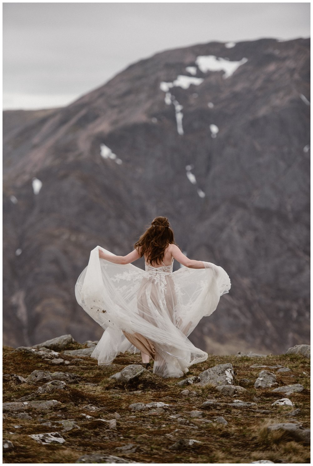 Elissa twirls her dress in the Scottish Highlands following her destination elopement. Photo by Maddie Mae, Adventure Instead.