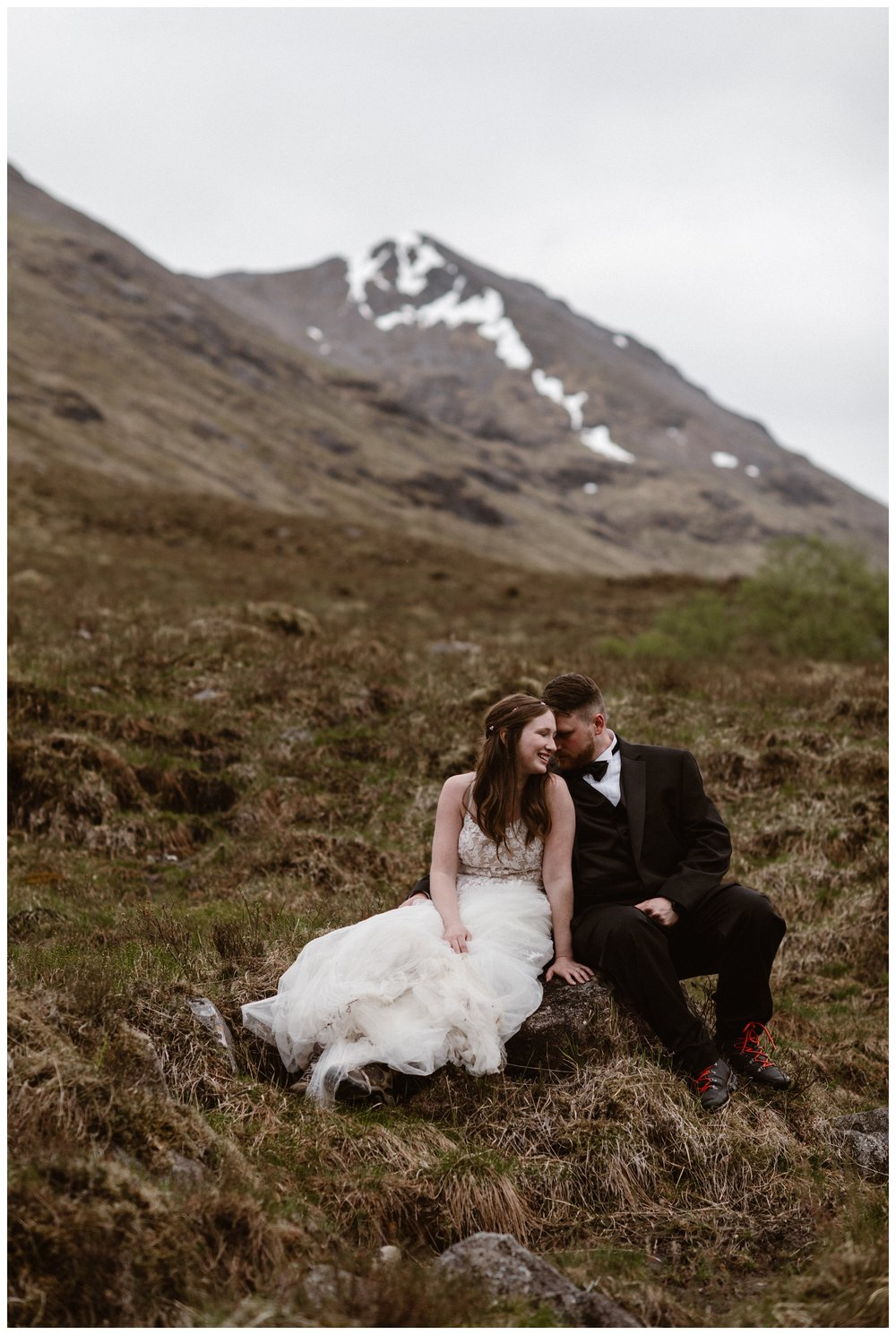 Elissa and Daniel sit in the marsh of the Scottish Highlands following their self solemnizing elopement ceremony where the only witnesses were me as their photographer and a few ptarmigans. Photo by Maddie Mae, Adventure Instead.