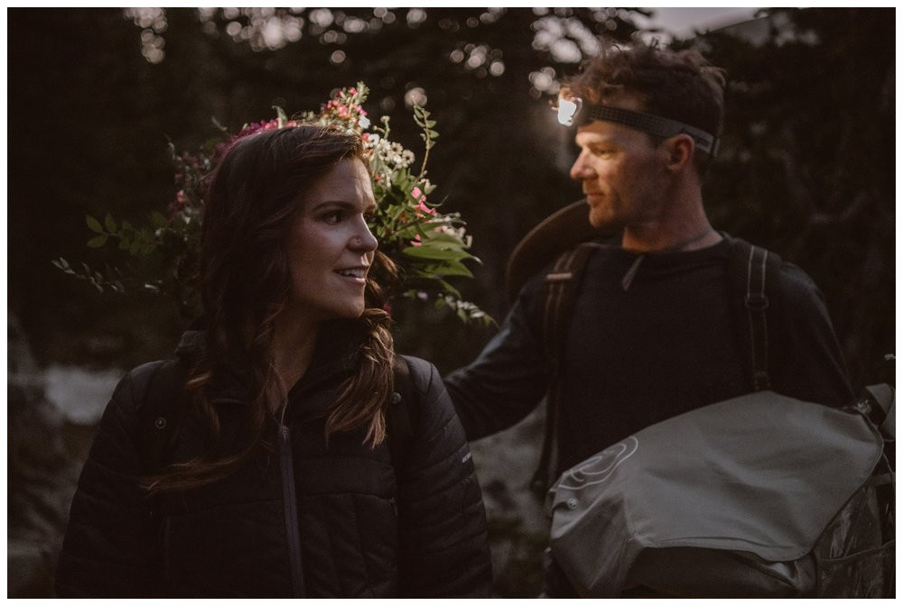 Karen carries her bouquet on her back for her adventure elopement with Matt as they hike up to Lake Isabelle before dawn. Photo by Adventure Instead, Maddie Mae.