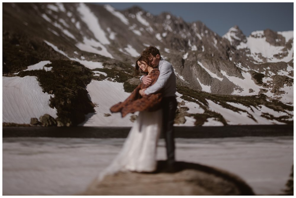 Karen and Matt embrace following their Lake Isabelle elopement ceremony outside Nederland, Colorado. They chose to hike to their self solemnizing ceremony. Photo by Adventure Instead, Maddie Mae.