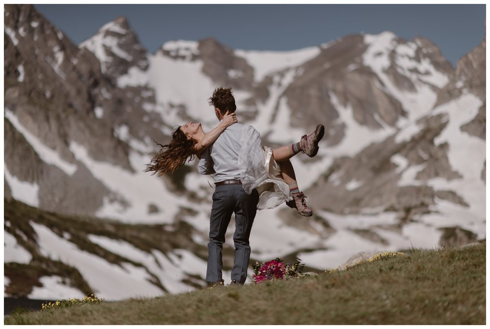 Karen and Matt spin after their high alpine lake elopement ceremony outside Nederland, Colorado. They hiked to the top of Lake Isabelle for their self solemnizing ceremony. Photo by Adventure Instead, Maddie Mae.
