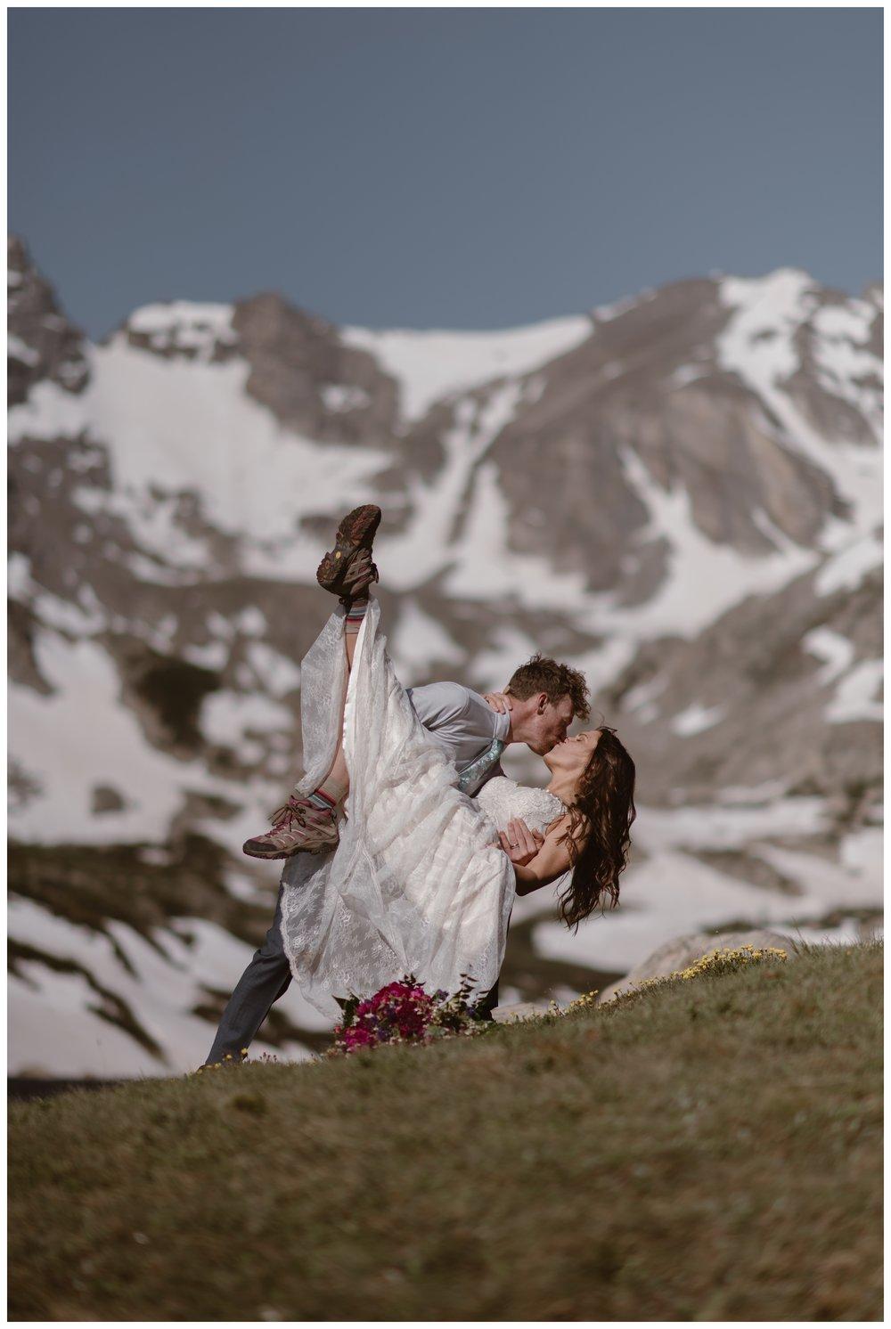 Matt dips his new bride Karen following their high alpine lake elopement ceremony outside Lake Isabelle, above Brainard Lake in Nederland, Colorado. Photo by Adventure Instead, Maddie Mae.