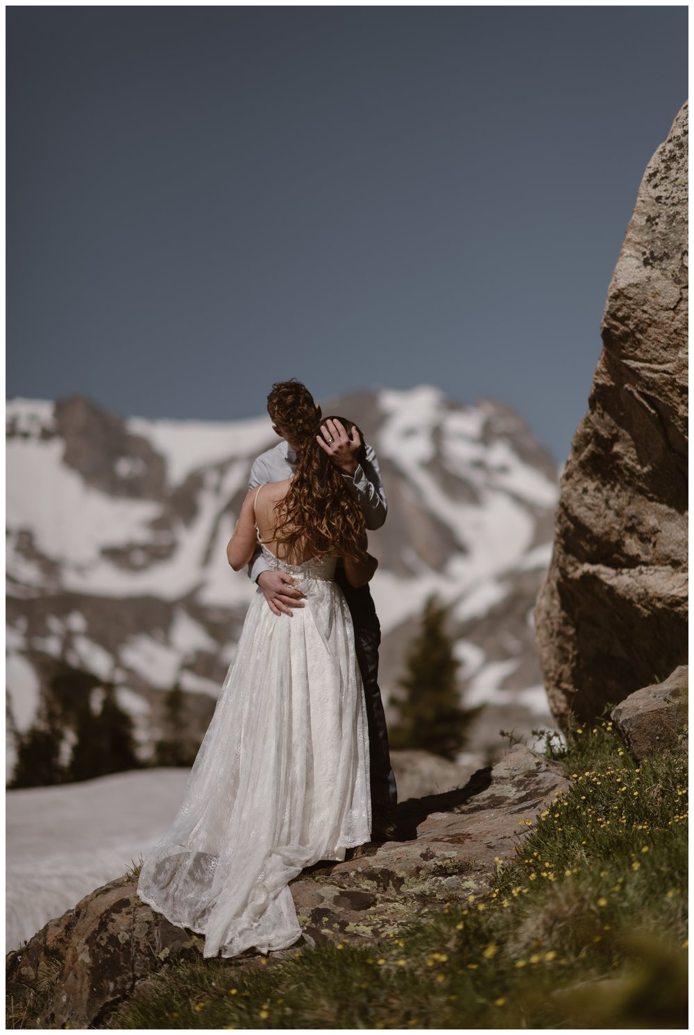 Karen and Matt embrace following their high alpine lake elopement ceremony on the shores of Lake Isabelle in Nederland, Colorado in the early morning hours. Photo by Adventure Instead, Maddie Mae.