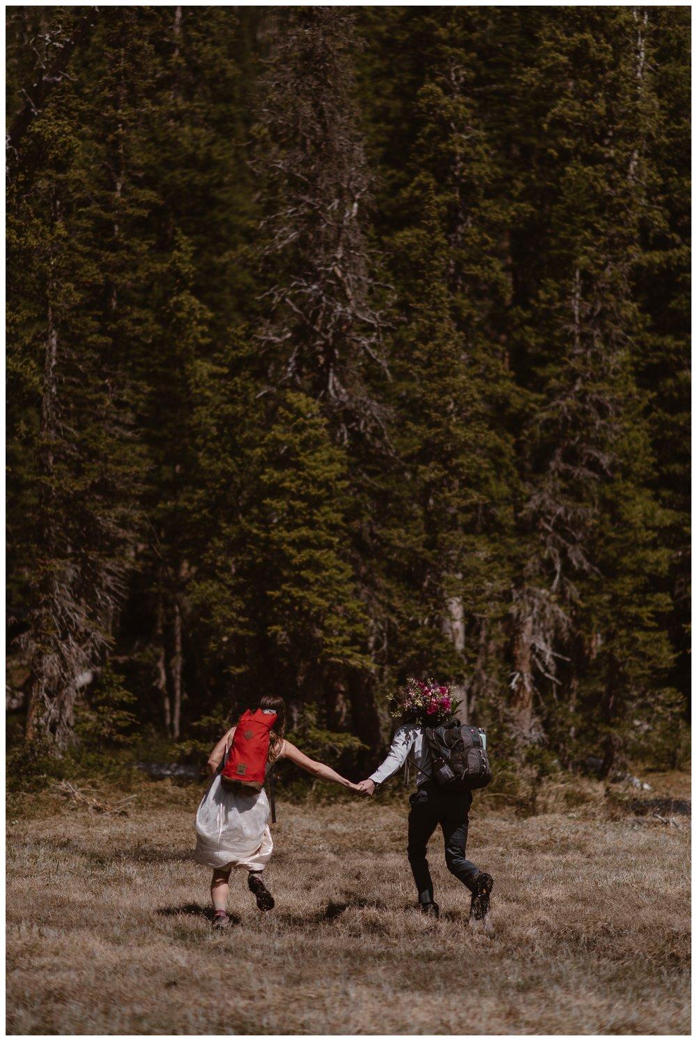 Karen and Matt begin the hike down following their high alpine adventure lake elopement ceremony in Nederland, Colorado. Photo by Adventure Instead, Maddie Mae.