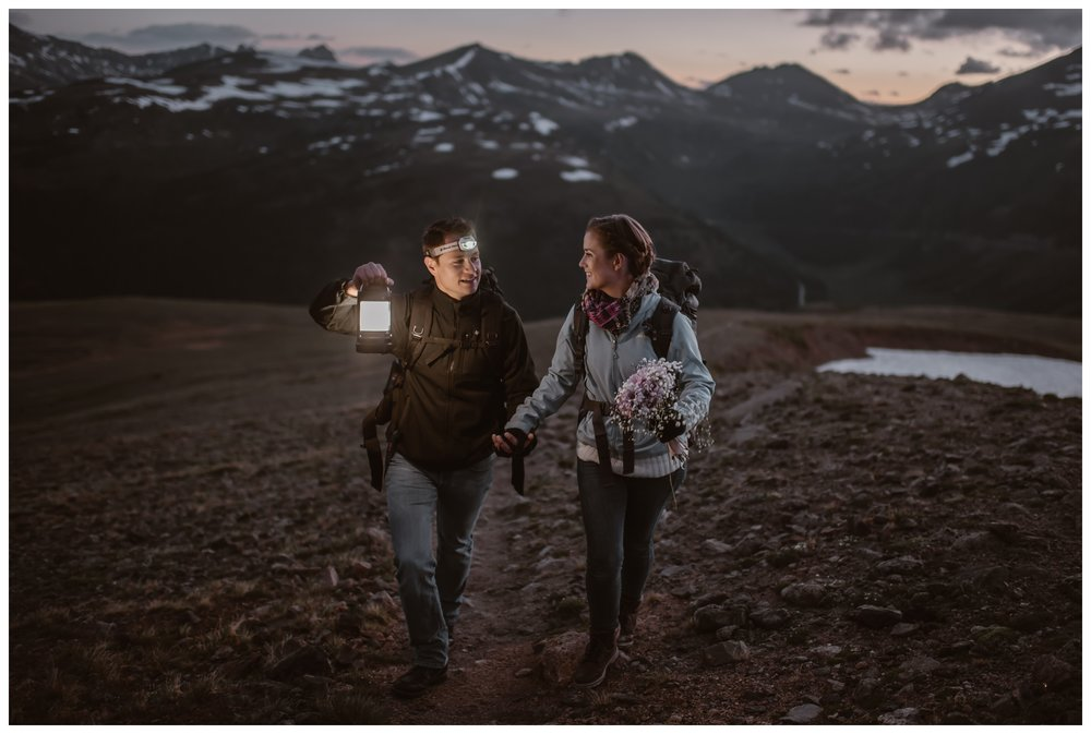 With the sun beginning to rise, Marcela and Vasily hike to the summit above Independence Pass in Colorado's Rocky Mountains for their intimate two person elopement. Photo by Maddie Mae, Adventure Instead.