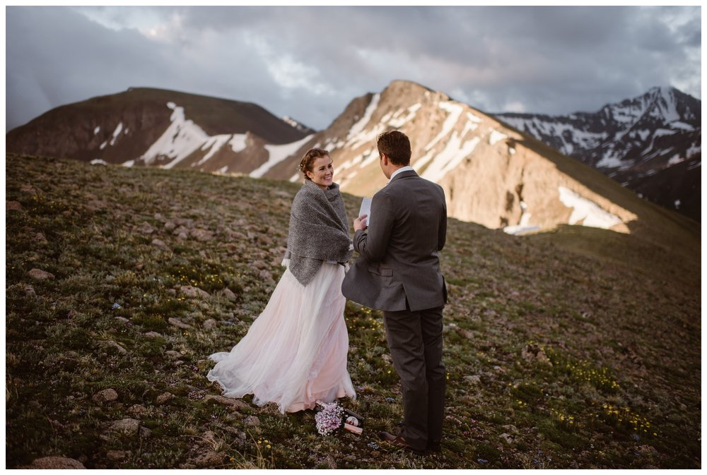 Surrounded by alpenglow as the sun begins to rise, Marcela and Vasily say their vows during their intimate elopement. Photo by Maddie Mae, Adventure Instead.
