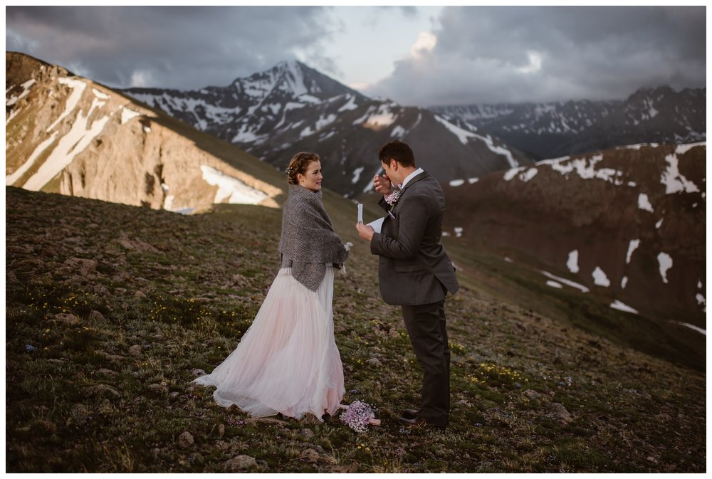 Vasily wipes away a tear reading his vows to his bride as the sun begins to rise around them above Independence Pass outside Aspen, Colorado. Photo by Maddie Mae, Adventure Instead.