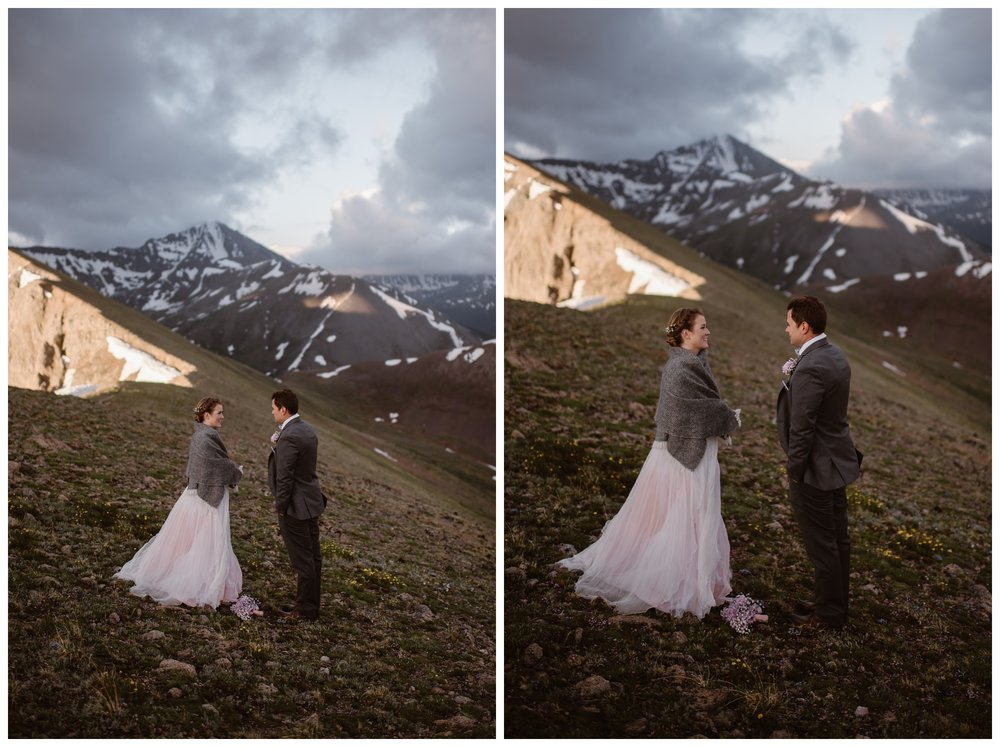 Marcela and Vasily read their vows to each other during their self solemnizing intimate two person elopement ceremony at the top of Independence Pass outside Aspen Colorado. Photo by Maddie Mae, Adventure Instead.