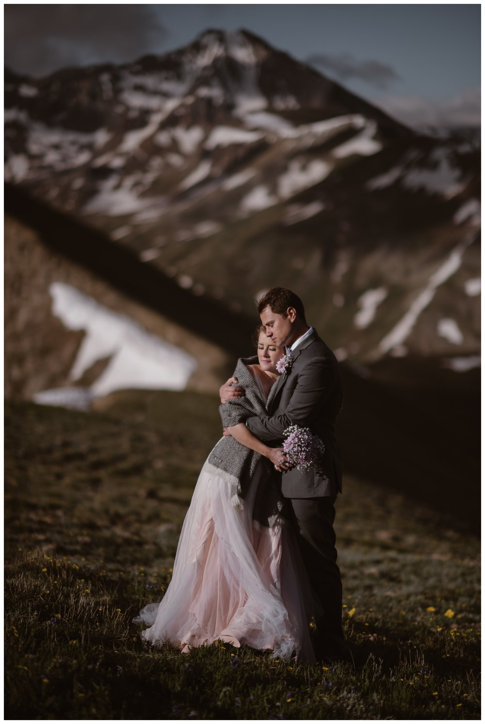 Marcela and Vasily embrace at the top of Independence Pass after their intimate elopement, with only the two of them in attendance. Photo by Maddie Mae, Adventure Instead.