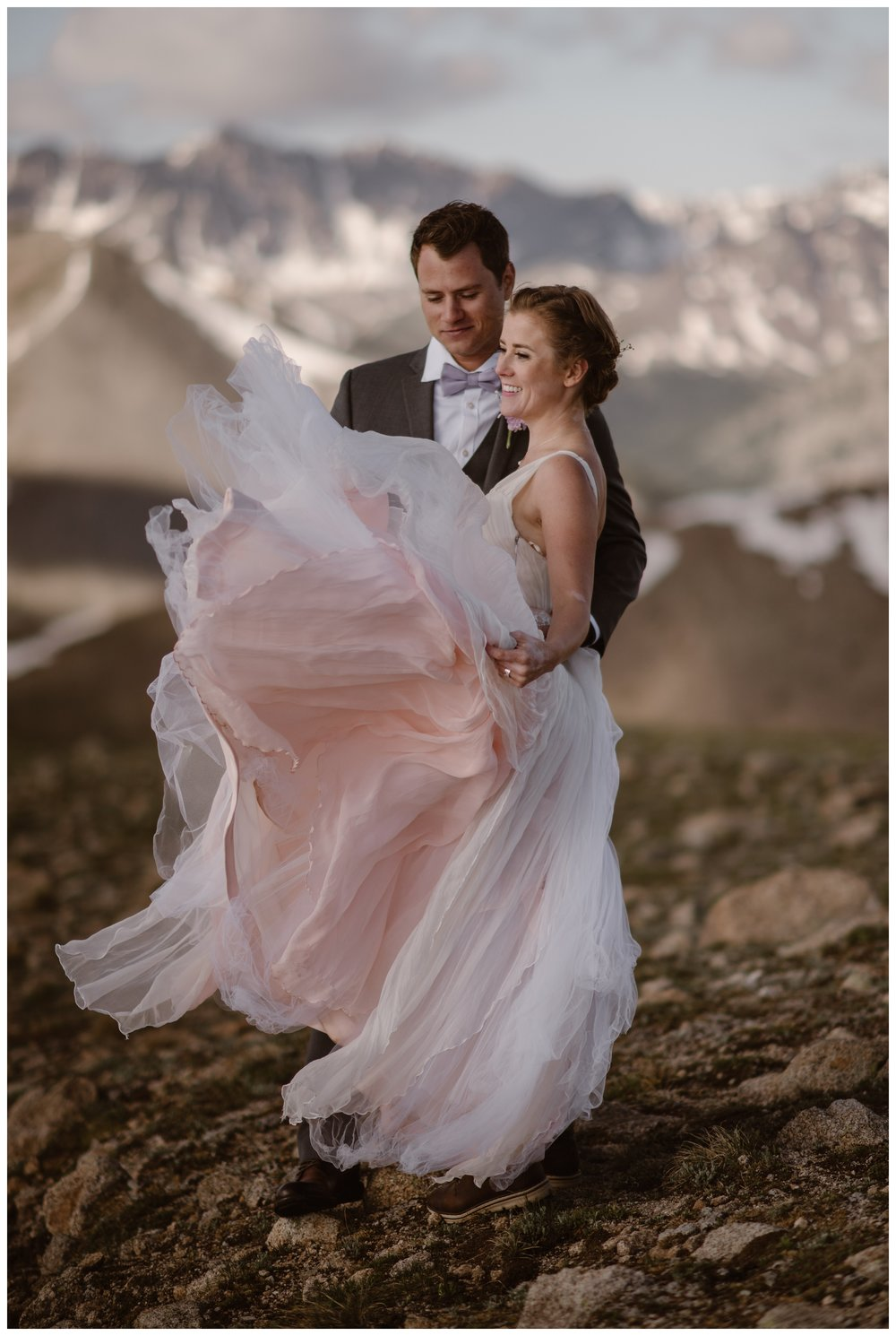 Marcela twirls her blush colored wedding dress with the jagged peaks of the Sawatch Range behind her after her elopement ceremony. Photo by Maddie Mae, Adventure Instead.
