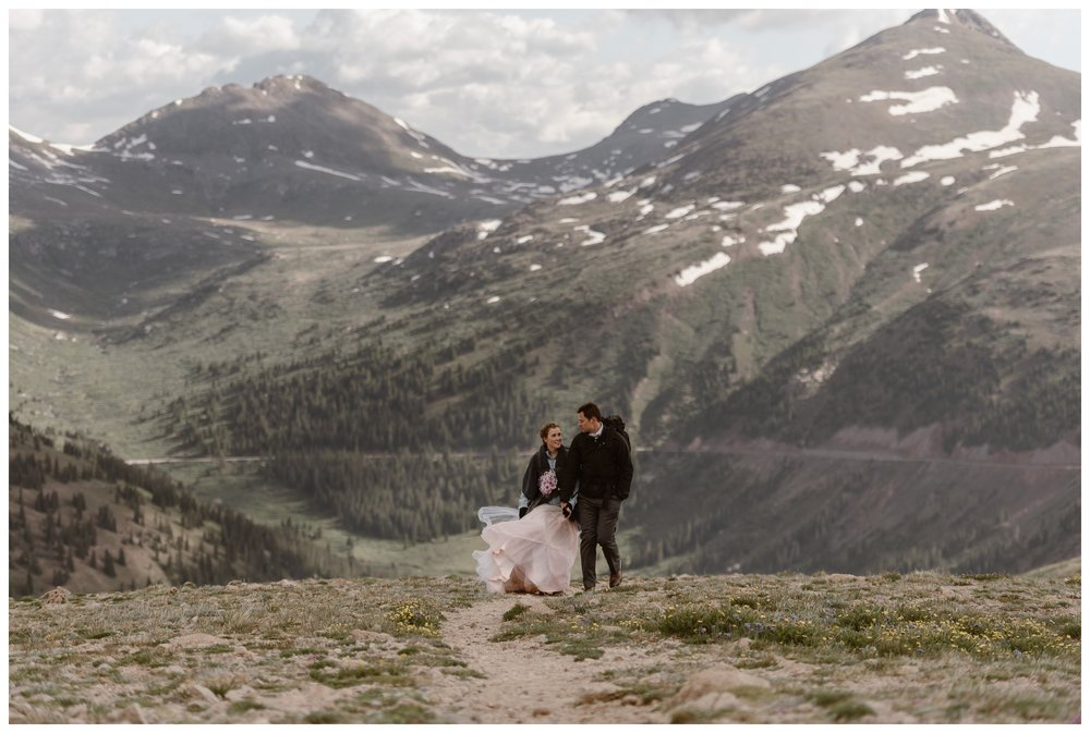 Marcela and Vasily hike along the ridge at the top of Independence Pass after their elopement ceremony. Photo by Maddie Mae, Adventure Instead.