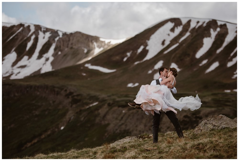 Marcela and Vasily embrace at the top of Independence Pass, outside Aspen, Colorado, following their hiking elopement ceremony. Photo by Maddie Mae, Adventure Instead.