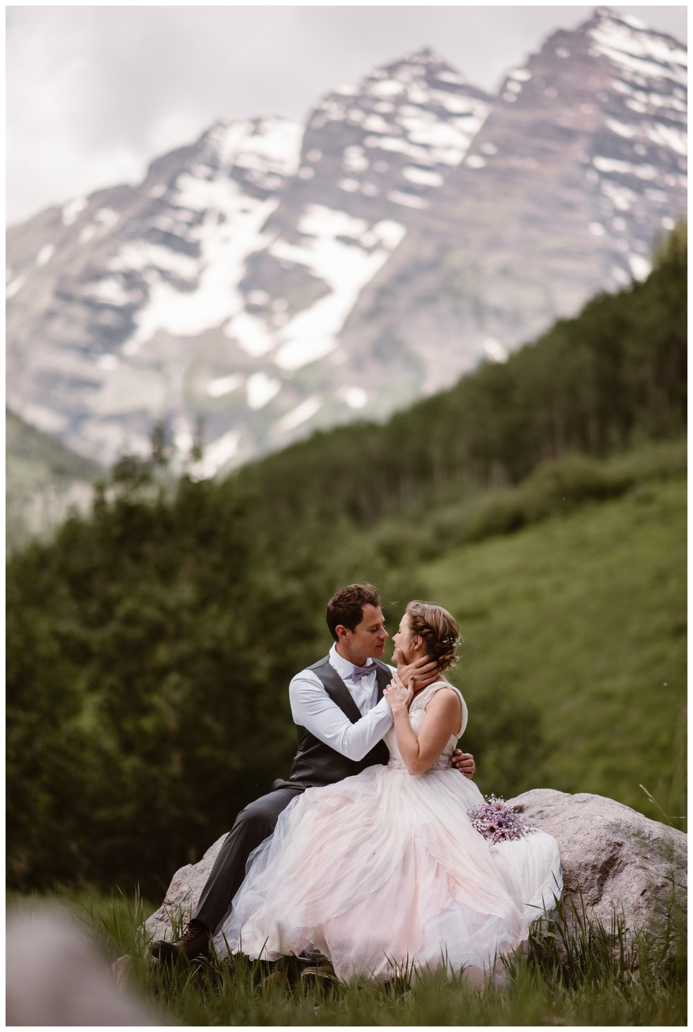 With Colorado's famous Maroon Bells behind them, Marcela and Vasily embrace following their intimate elopement ceremony. Photo by Maddie Mae, Adventure Instead.