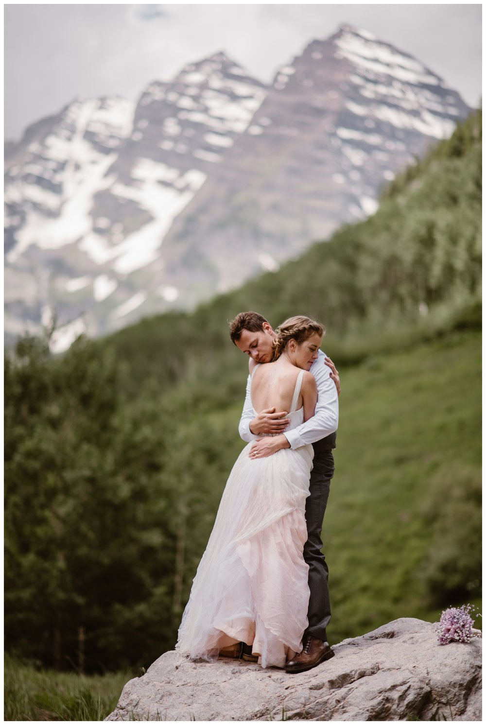 Marcela and Vasily ended their epic hiking elopement day with a trip to the famous Maroon Bells in Aspen, Colorado. Photo by Maddie Mae, Adventure Instead.