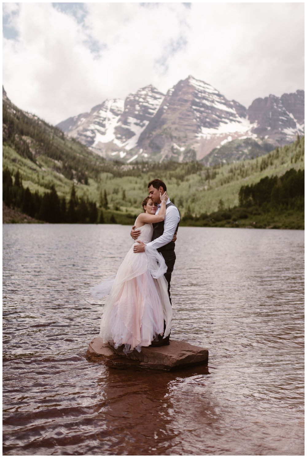 The Maroon Bells of Aspen, Colorado make for a stunning background for Marcela and Vasily's intimate elopement day. Photo by Maddie Mae, Adventure Instead.