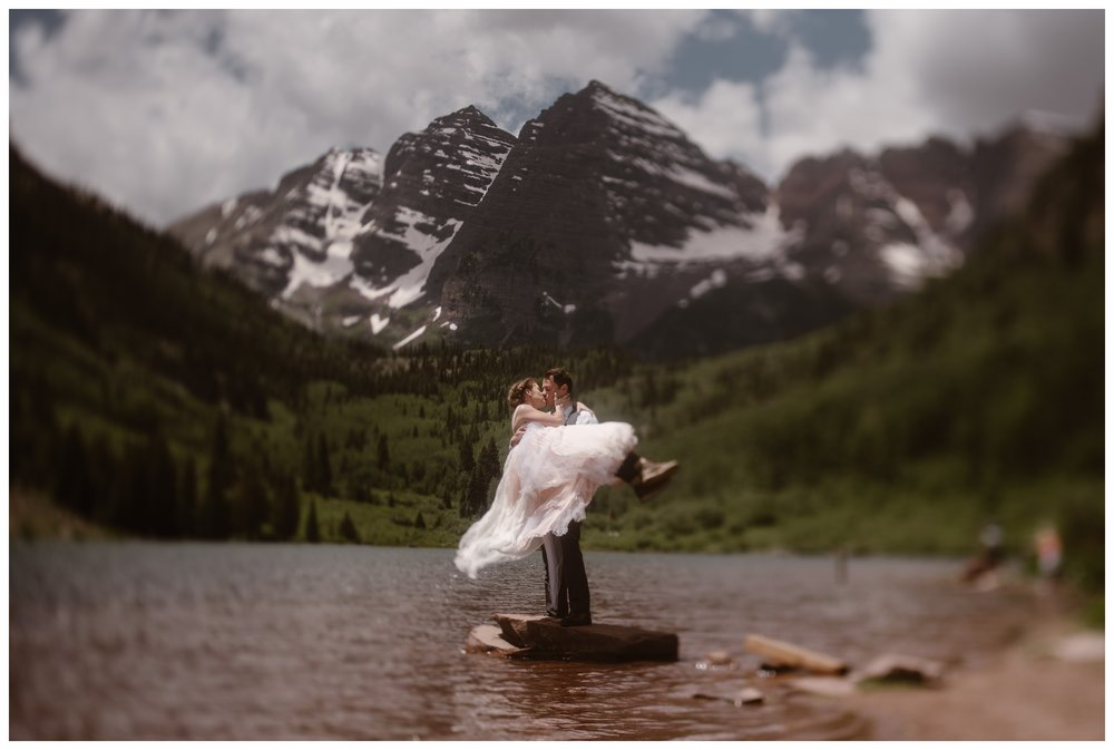 Marcela and Vasily embrace at the Maroon Bells, following their intimate elopement ceremony on the top of Independence Pass outside Aspen, Colorado. Photo by Maddie Mae, Adventure Instead.
