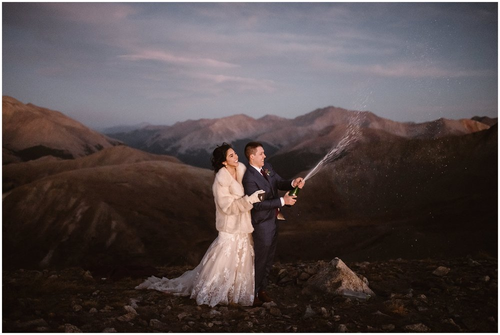 How will you celebrate at the end of your self solemnizing or self officiating elopement ceremony? Some couples choose to celebrate with champagne but remember, whatever you do to celebrate your elopement ceremony, leave no trace and don't litter. Photo by Adventure Instead, Maddie Mae.