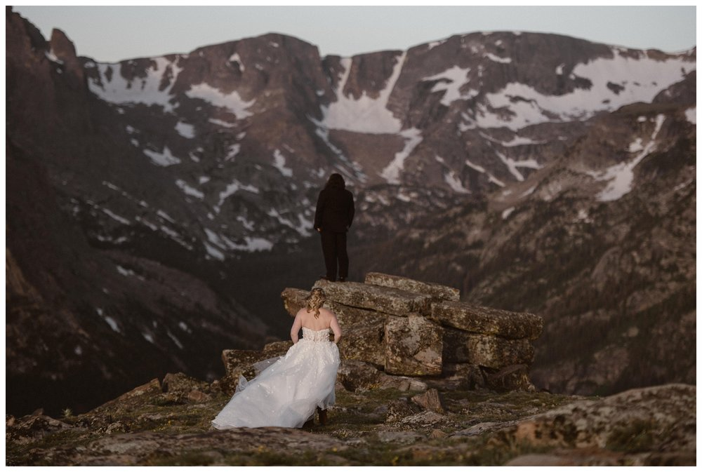 Alicia and Zach did their first look for their intimate adventure elopement wedding ceremony at the top of Trail Ridge Road in Rocky Mountain National Park, Colorado. Photo by Adventure Instead, Maddie Mae.