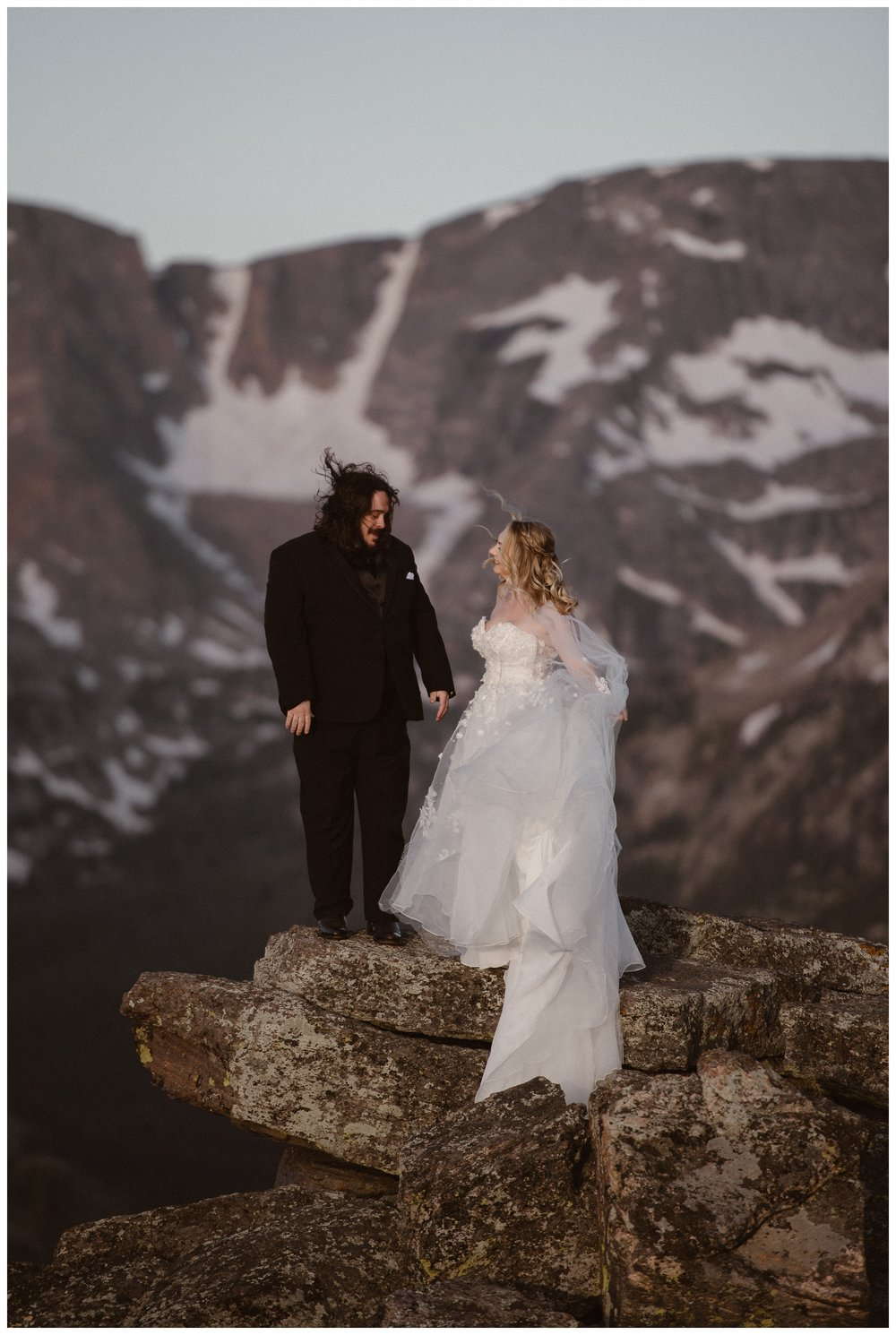 Alicia's bridal gown blows in the wind at the top of Trail Ridge Road in Rocky Mountain National Park during her first look. Photo by Adventure Instead, Maddie Mae.
