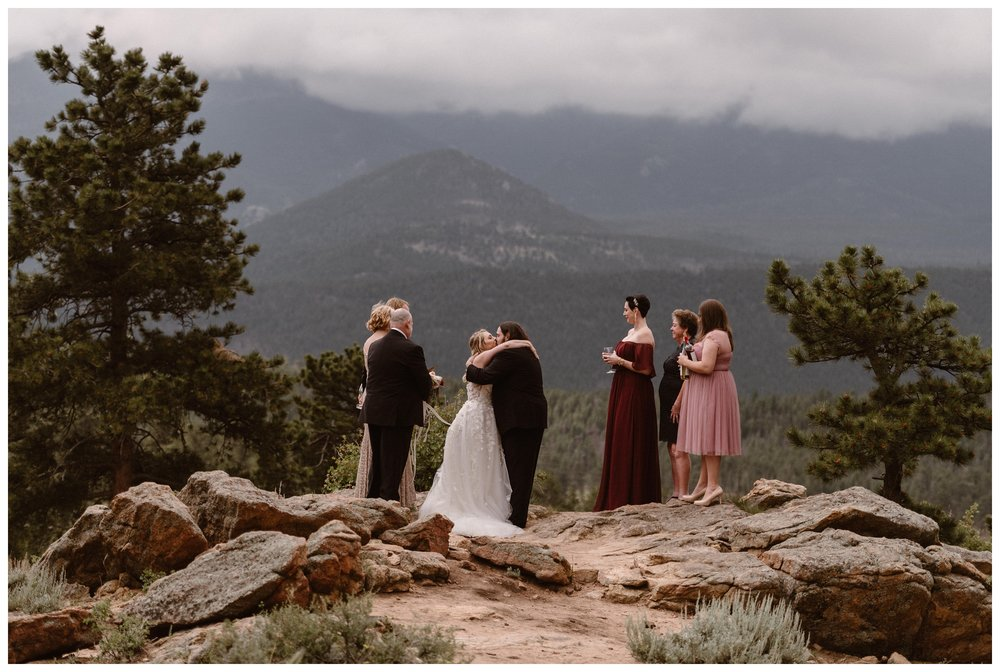 Alicia and Zach have their first kiss as husband and wife during their intimate elopement ceremony at Rocky Mountain National Park in Estes Park, Colorado. Photo by Adventure Instead, Maddie Mae.