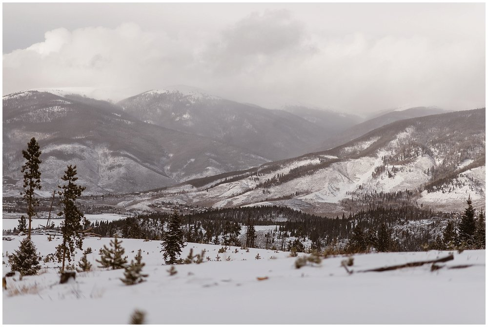 A snowy mountain ridge near Dillon and Breckenridge, Colorado was the perfect outdoor winter setting for Marlayna and Austin's snowy elopement. Photo by Adventure Instead, Maddie Mae Elopement Photographers.