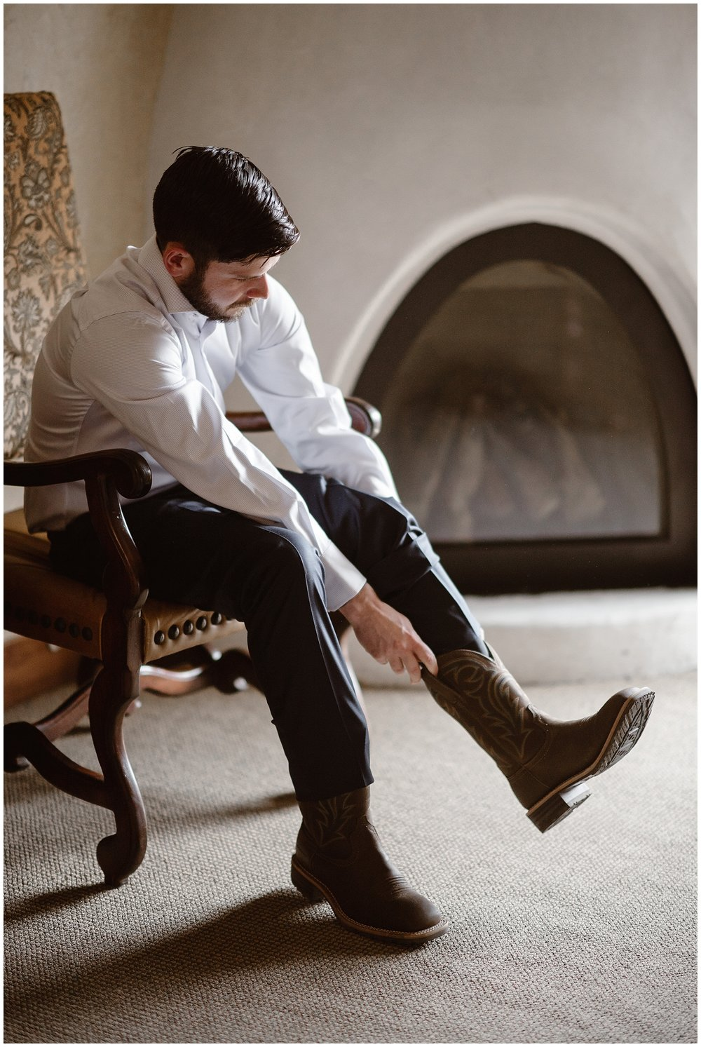 Austin chose to wear cowboy boots for his winter elopement ceremony at Sapphire Point in Dillon, Colorado.Photo by Adventure Instead, Maddie Mae Elopement Photographers.