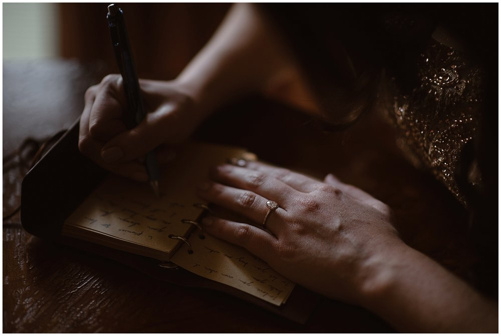 The bride writes her vows out by hand before her winter elopement ceremony. Photo by Adventure Instead, Maddie Mae Elopement Photographers.