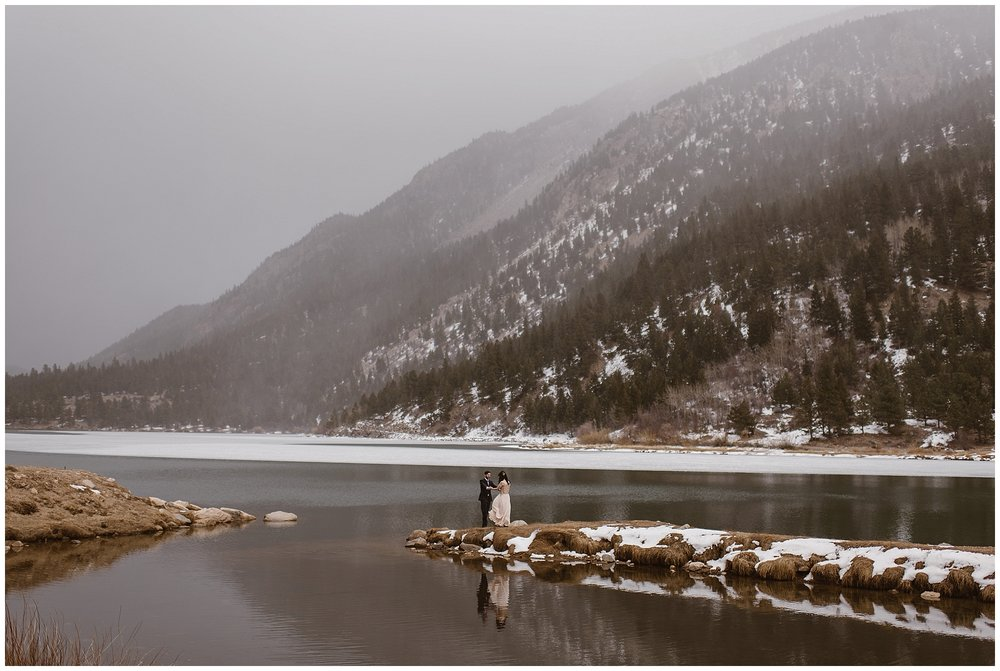 Having a first look before an intimate elopement ceremony is still possible! Marlayna and Austin got ready separately and then saw each other for the first time at Georgetown Lake with the snow capped peaks of Colorado's Rocky Mountains behind them. Photo by Adventure Instead, Maddie Mae Elopement Photographers.