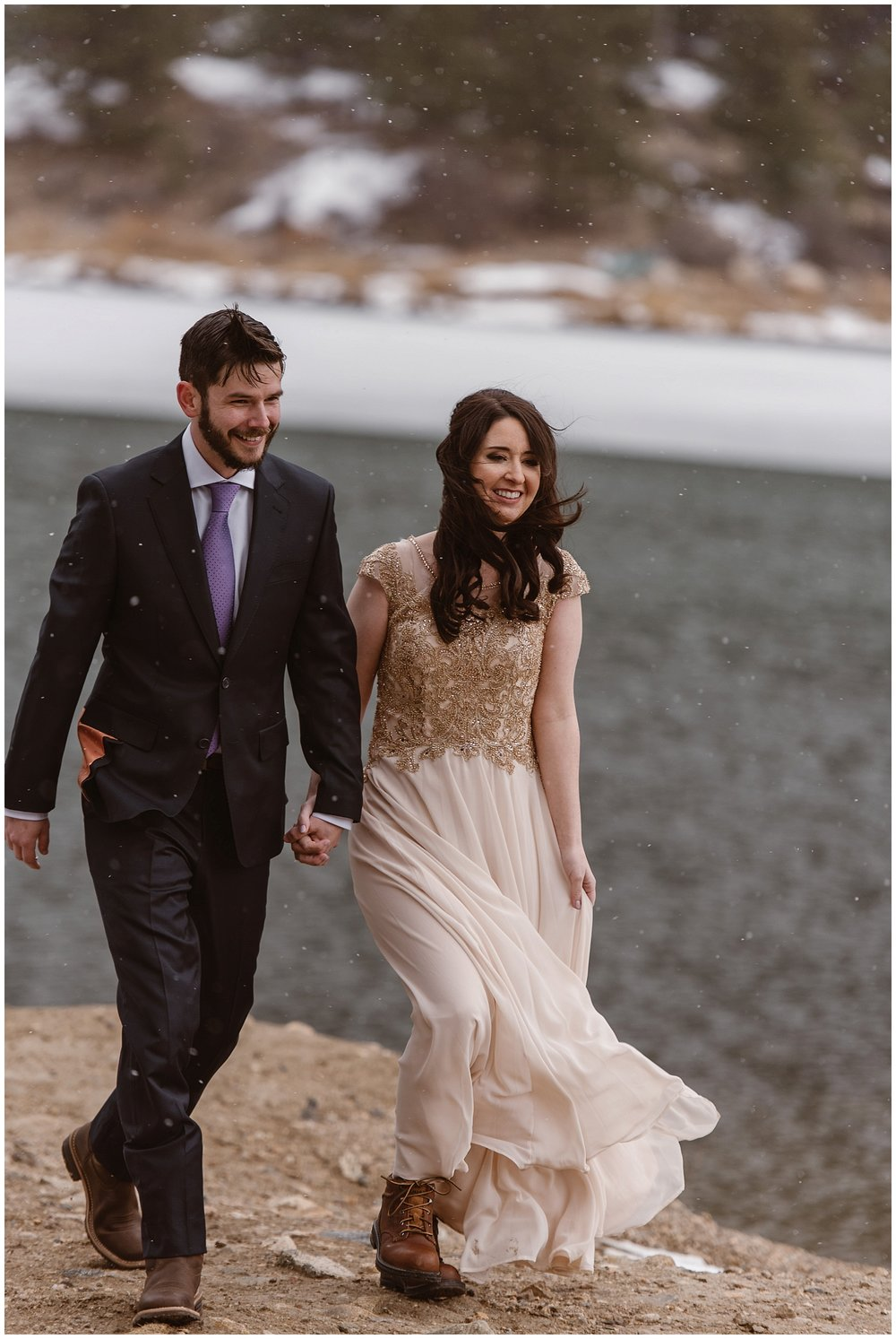 The snow started to gently fall before Marlayna and Austin's self solemnizing elopement ceremony in Sapphire Point, Dillon, Colorado. Photo by Adventure Instead, Maddie Mae Elopement Photographers.