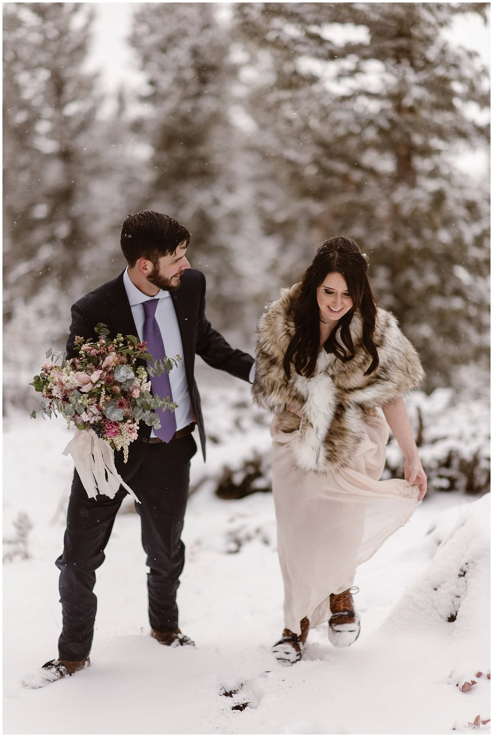 Marlayna and Austin walk through the snow for their snowy winter elopement ceremony. Photo by Adventure Instead, Maddie Mae Elopement Photographers.