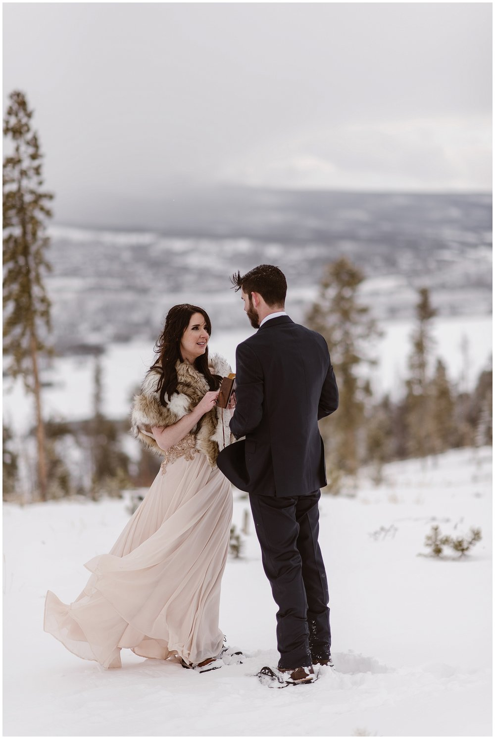 Marlayna and Austin had a self solemnizing ceremony at the top of a mountain at Sapphire Point during a snow storm. Photo by Adventure Instead, Maddie Mae Elopement Photographers.