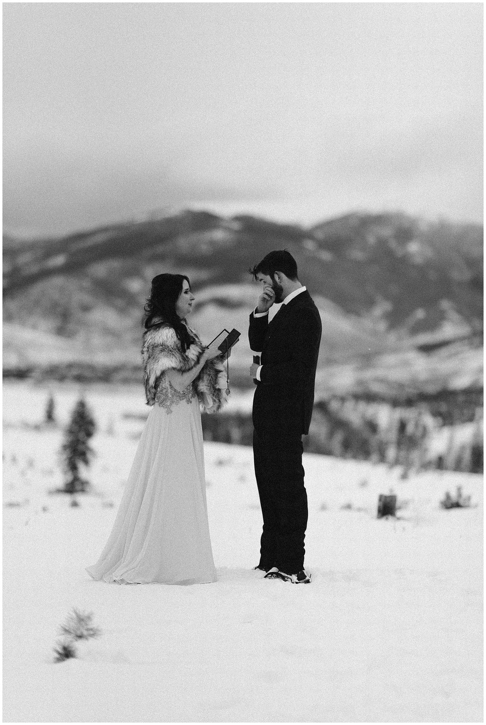 Marlayna and Austin had a winter elopement ceremony surrounded by the snowy Rocky Mountains at Sapphire Point in Dillon, Colorado. Photo by Adventure Instead, Maddie Mae Elopement Photographers.