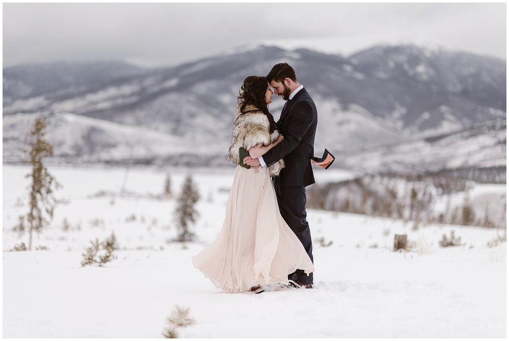 A winter elopement is possible. Marlayna and Austin eloped in the snow at Sapphire Point in Dillon, Colorado. Photo by Adventure Instead, Maddie Mae Elopement Photographers.