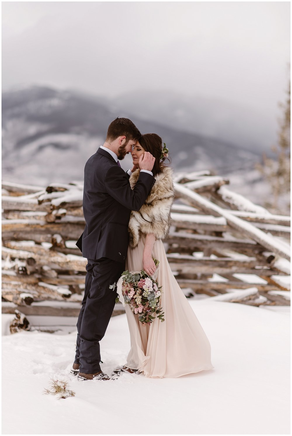 Marlayna's blush wedding dress was stunning in the snowy mountain setting of their elopement day. Photo by Adventure Instead, Maddie Mae Elopement Photographers.