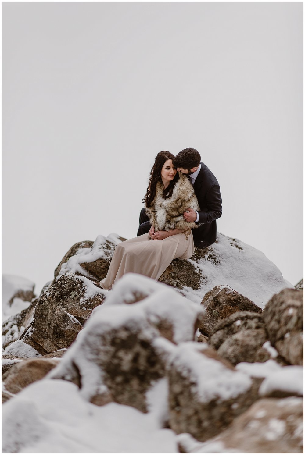 To stay warm during a winter elopement, it's important to take lots of breaks, wear a warm coat and dress in lots of layers. Marlayna and Austin eloped at Sapphire Point in Dillon, Colorado. Photo by Adventure Instead, Maddie Mae Elopement Photographers.