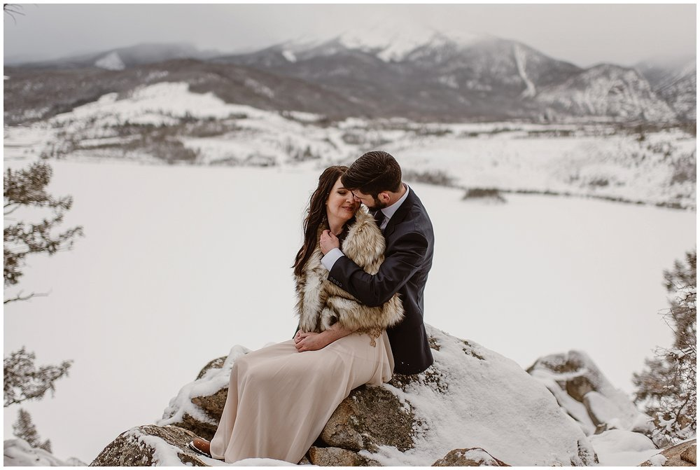 Marlayna and Austin embrace at the top of Sapphire Point in Dillon, Colorado. Photo by Adventure Instead, Maddie Mae Elopement Photographers.