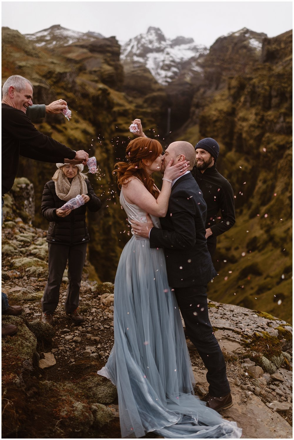 If you have guests present during your elopement day, you can have them sprinkle you with flower petals as you have your first kiss. Make sure that it's allowed at your elopement location and always leave no trace! Where you elope and how you say your vows matters! Photo by Maddie Mae, Adventure Instead Elopement Photographers.