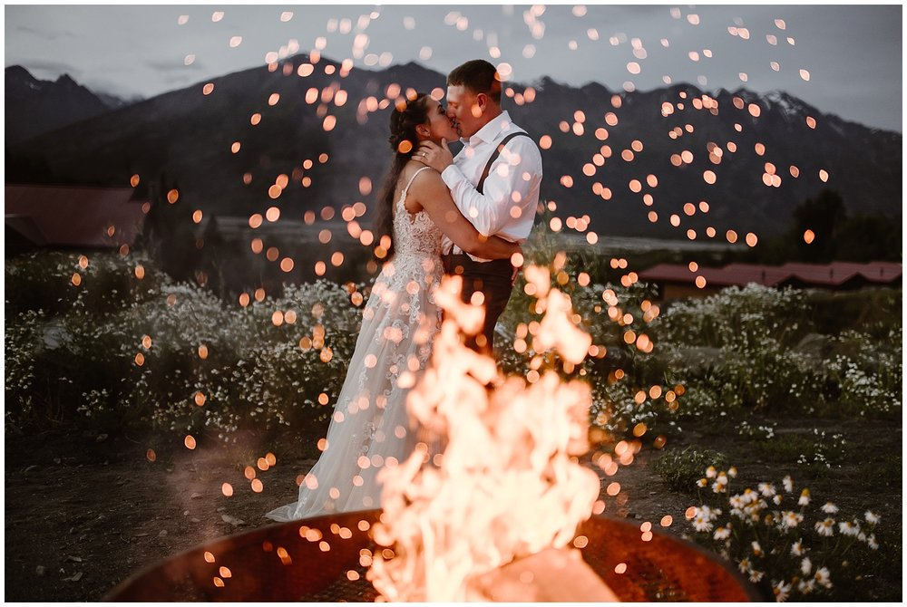 This couple chose to have their first dance as a married couple following their elopement vows by a campfire in Alaska. Where you elope and how you say your vows matters! Photo by Maddie Mae, Adventure Instead Elopement Photographers.