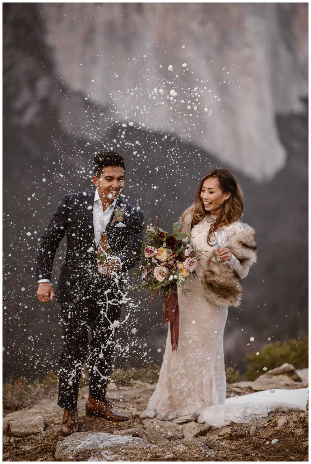Once you've said your vows it's time to celebrate! The key to a great champagne spray is to really shake the champagne, like this couple did following their Yosemite National Park elopement ceremony! Where you elope and how you say your vows matters! Photo by Maddie Mae, Adventure Instead Elopement Photographers.