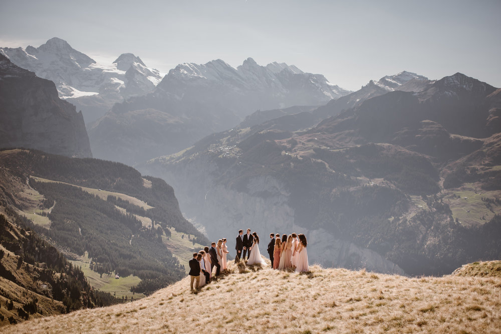 The Swiss Alps make for a stunning backdrop for a destination elopement ceremony! When you can elope anywhere in the world, knowing how to pick the best elopement location can be a challenge. We've traveled the world as destination elopement photographers and have complied a list of ways to find the best elopement location for your dream elopement ceremony. Photo by Adventure Instead, Maddie Mae, Destination Wedding Elopement Photographers.