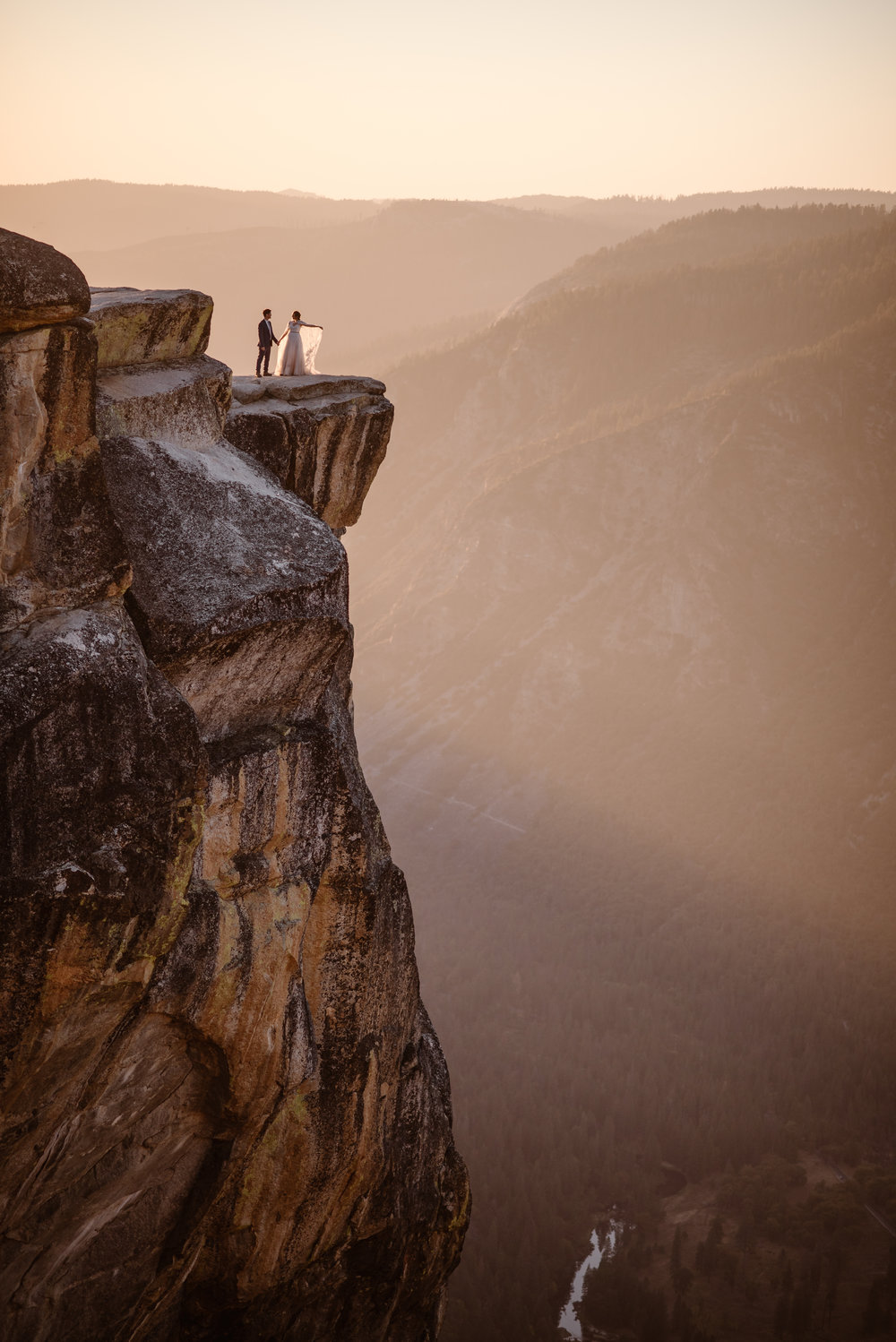 Where you elope and how you say your vows matters! This couple chose to elope on top of Yosemite Canyon in Yosemite National Park. Photo by Maddie Mae, Adventure Instead Elopement Photographers.