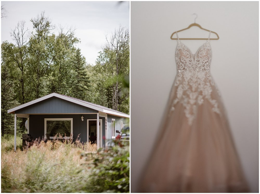 This split shot displays two images — on the left side, there's a view of a tiny, adorable, light blue colored home in the Alaska wilderness. On the right side of this split image, which was taken by adventure elopement photographer Adventure Instead, is a white and gold wedding dress with sequined beads hanging on the hanger against a white wall.