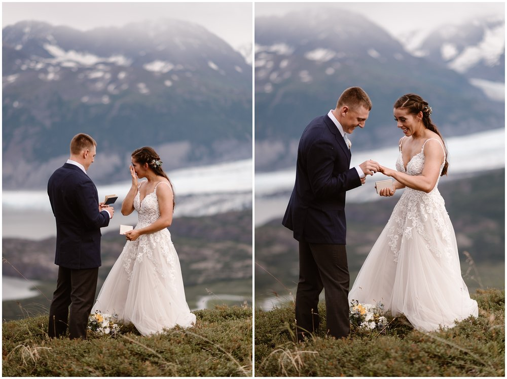 This side-by-side image shows Jordyn and Connor as they place Jordyn's ring on her finger . In the picture on the left, Jordyn stands in front of Connor, wiping away tears as they finish reading their vows n their Alaska elopement ceremony. In the photo of the right, captured by elopement wedding photographer Adventure Instead, Connor places the ring on Jordyn's finger as they both smile.