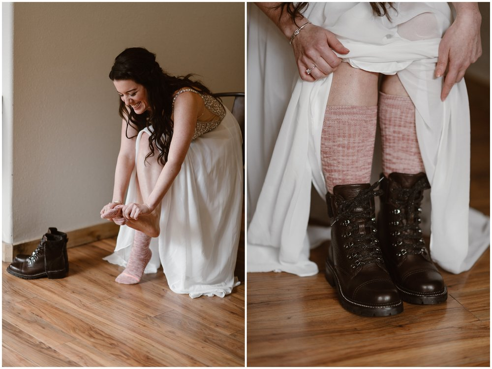 In these side-by-side elopement photos captured by elopement photographer Adventure Instead, the bride (Katie) continues to get ready for her adventure elopement by putting on her dark brown hiking boots. In the elopement picture on the left, Katie pulls on her pink and white marbled socks, then, in the picture to the right, Katie pulls up her wedding dress to reveal her high socks and boots tied up tight.