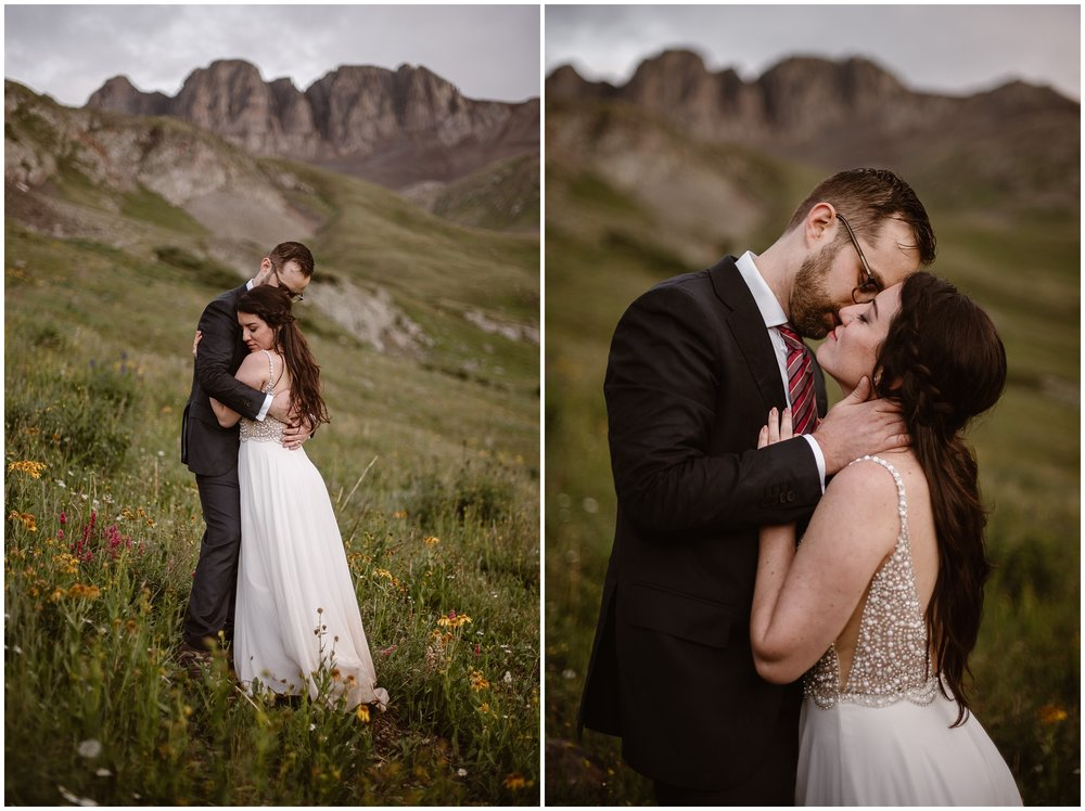 These side-by-side elopement photos capture Katie and Logan, the bride and the groom, embracing and nuzzling on a Colorado mountainside. In the elopement picture on the left, Katie leans into a hug from Logan in the meadow, wildflowers all around them in shades of pink, yellow, and orange. In the photo to the right, Katie and Logan lean in close for a kiss.