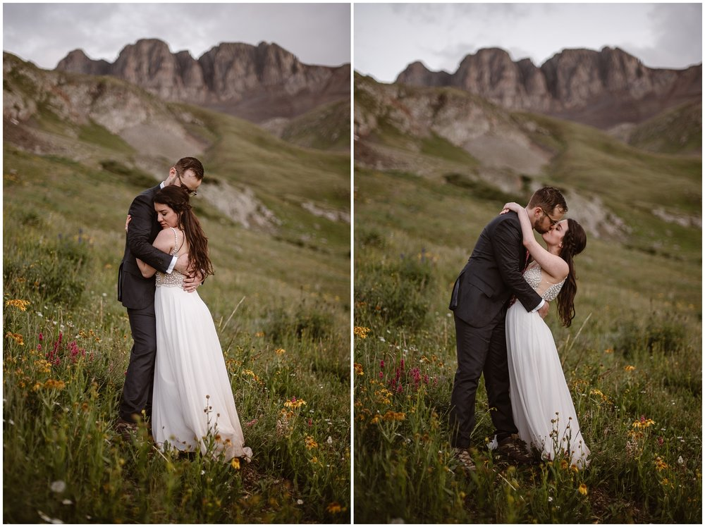 Katie and Logan, the bride and groom, embrace and hold each other close in these side-by-side elopement photos captured by Adventure Instead., an elopement wedding photographer. In these images, Katie and Logan stand in a meadow with red and yellow wildflowers by their feet and a granite mountain in the background.