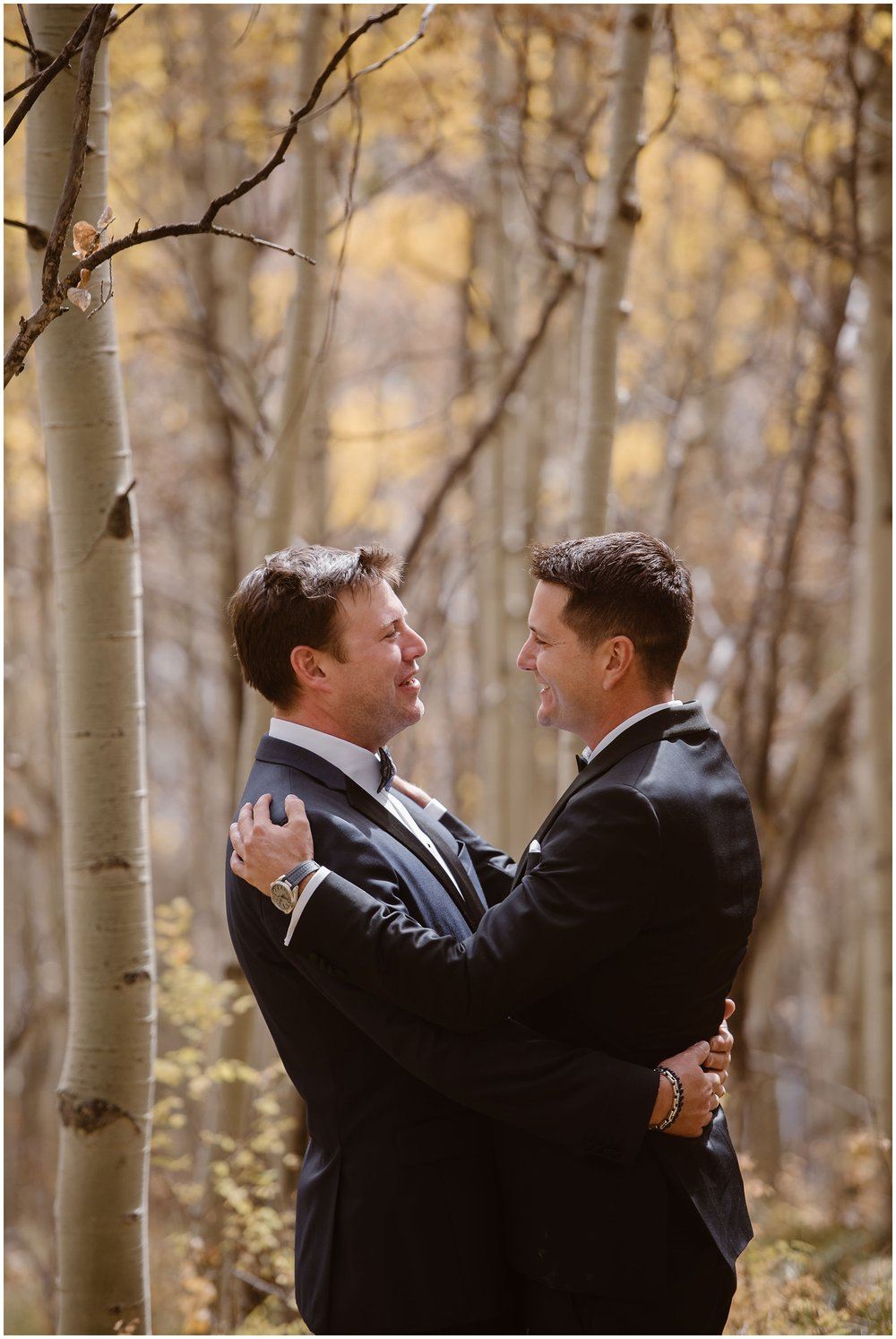 Brian and Ernie, the two grooms, embrace each other in the middle of a beautiful aspen grove in Colorado. Their dark suits contrast beautifully against the white aspen trunks and the bright gold leaves. These elopement photos were one of the unique eloping ideas that Brian and Ernie wanted for their Colorado mountain wedding.