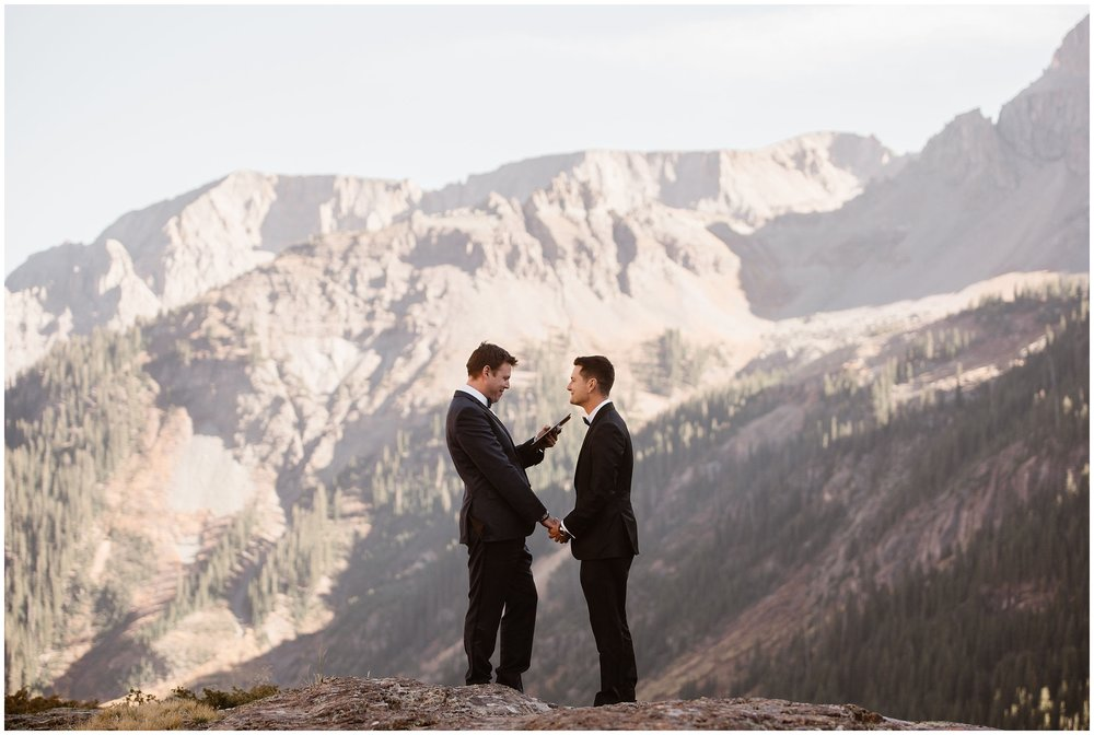 Brian and Ernie hold hands as they read their vows to each other in their own private elopement ceremony. They chose to have an intimate ceremony for just the two of them, followed by a ceremony focused on eloping with family.